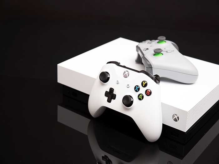 White xbox one with controllers